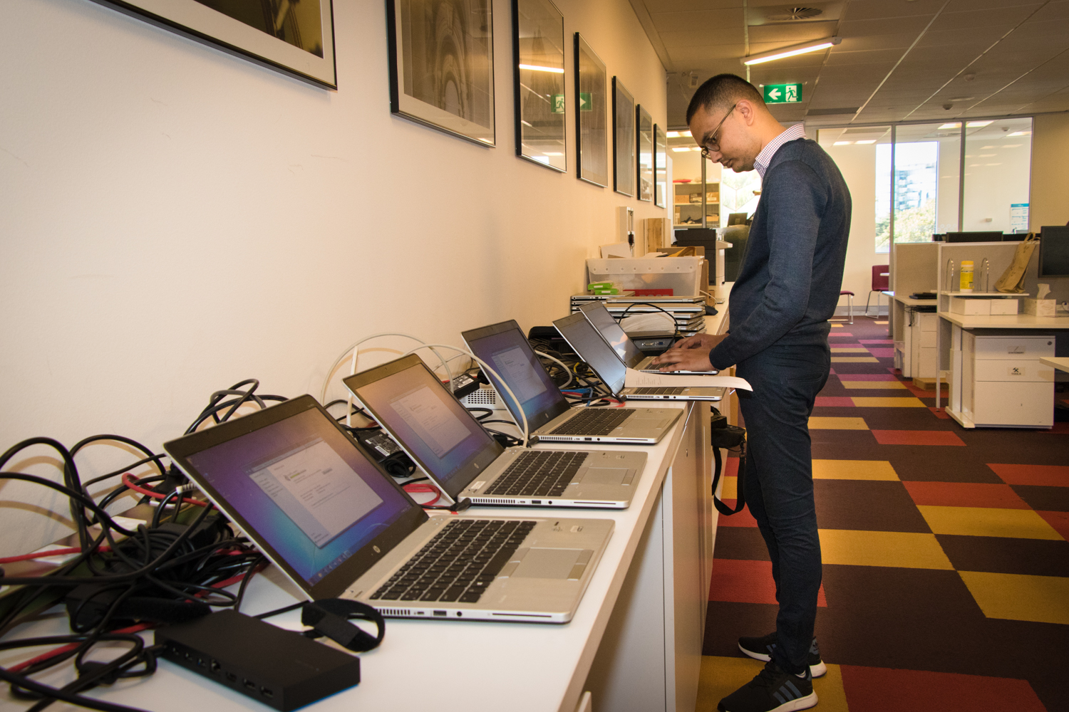 Staff prepare laptops for the Parliament of Tonga
